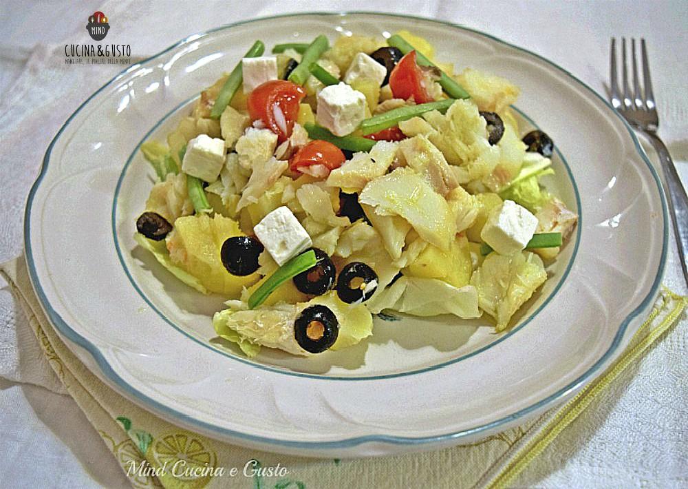 Insalata tiepida di baccalà con patate e olive nere